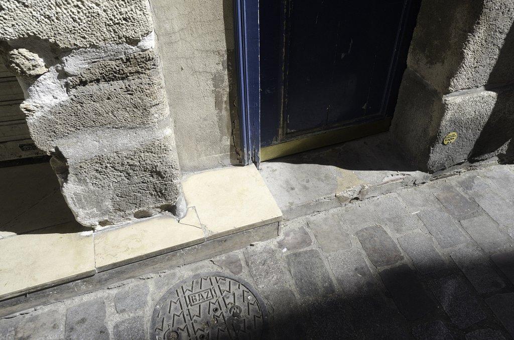 Blue Door on Cobbled Street