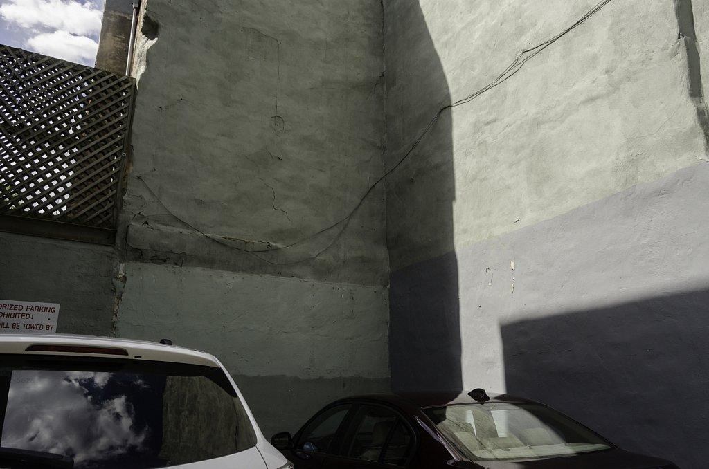 Greenish Wall Above Cars
