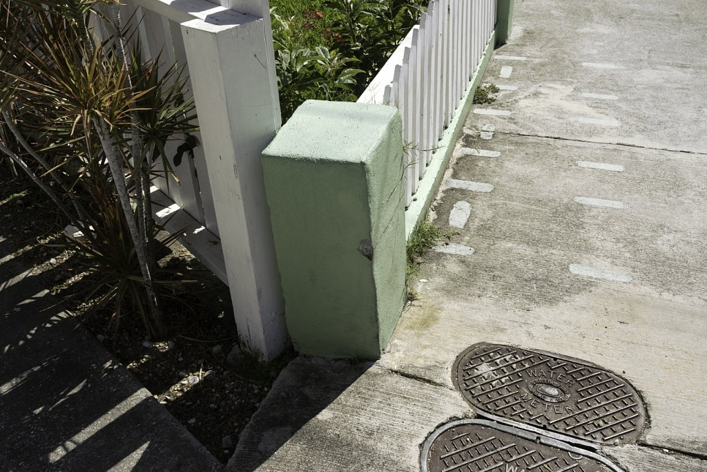 Green Post and Sidewalk